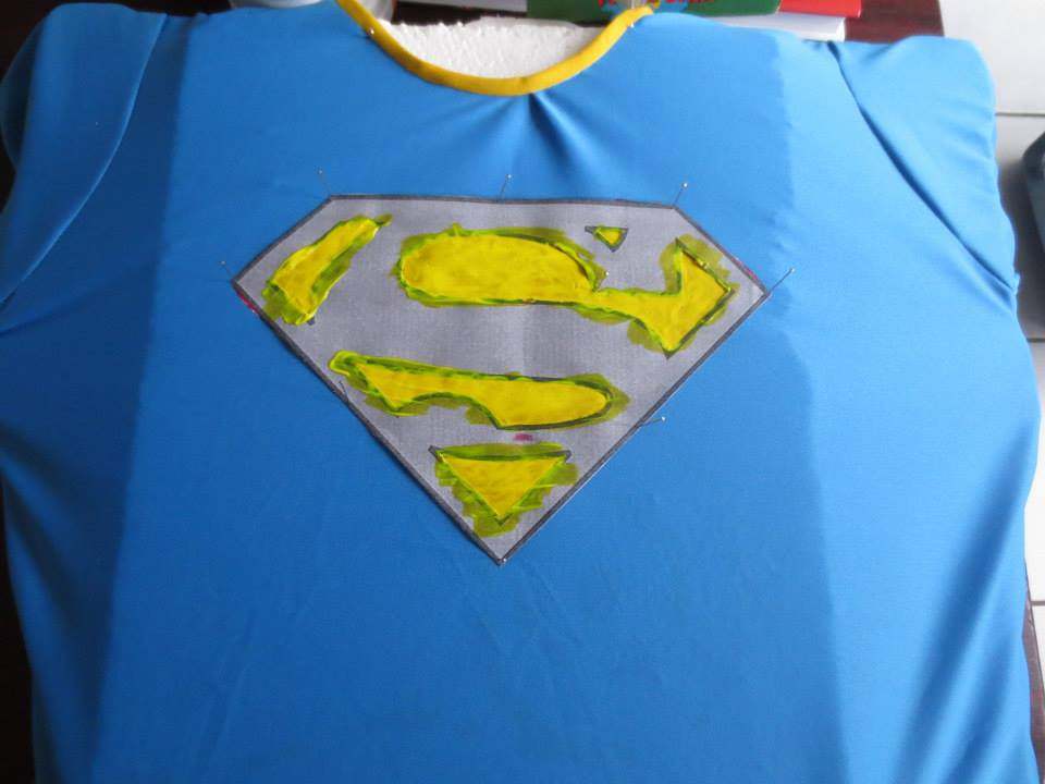 Supergirl Cosplay painted the 'Super' symbol on with fabric paint
