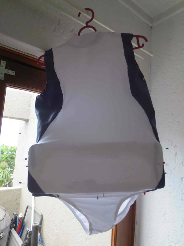 Work in progress picture of white leotard drying with purple paint