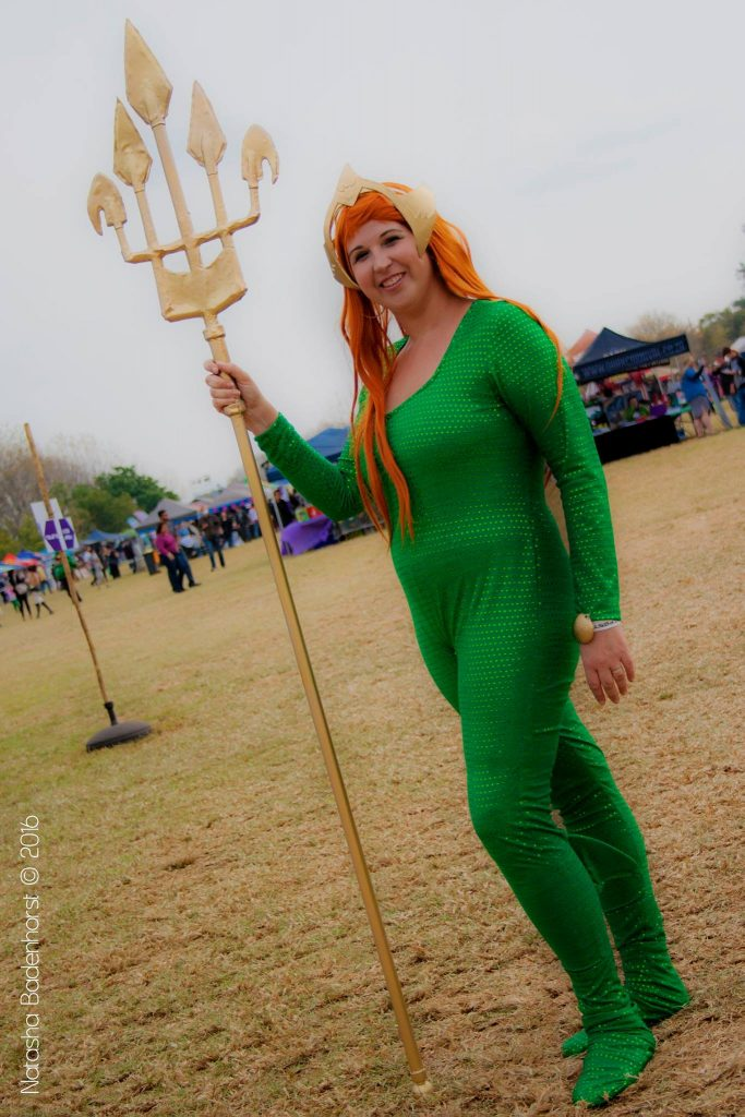 Mera Cosplay posing at Geekfest 2016 smiling with trident at her side