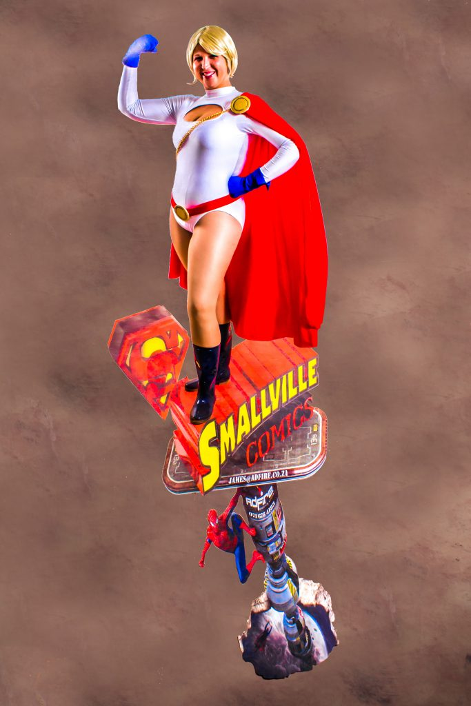 Power Girl Cosplay standing on a Smallvile Comics logo