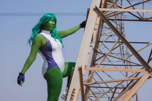 she-hulk cosplay standing on the side of an electric pylon