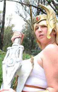 She-ra cosplay. She-ra holding her sword in ceremonial position.