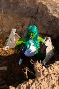 she-hulk cosplay in a hole pulling a computer apart