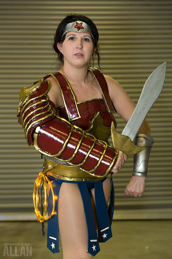 Wonder Woman Divine Armour Cosplay posing with sword