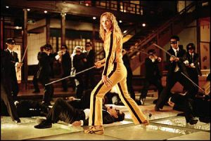 A still from Kill Bill Vol 1 Movie. Uma Thurman as The Bride surrounded by The Crazy 88s