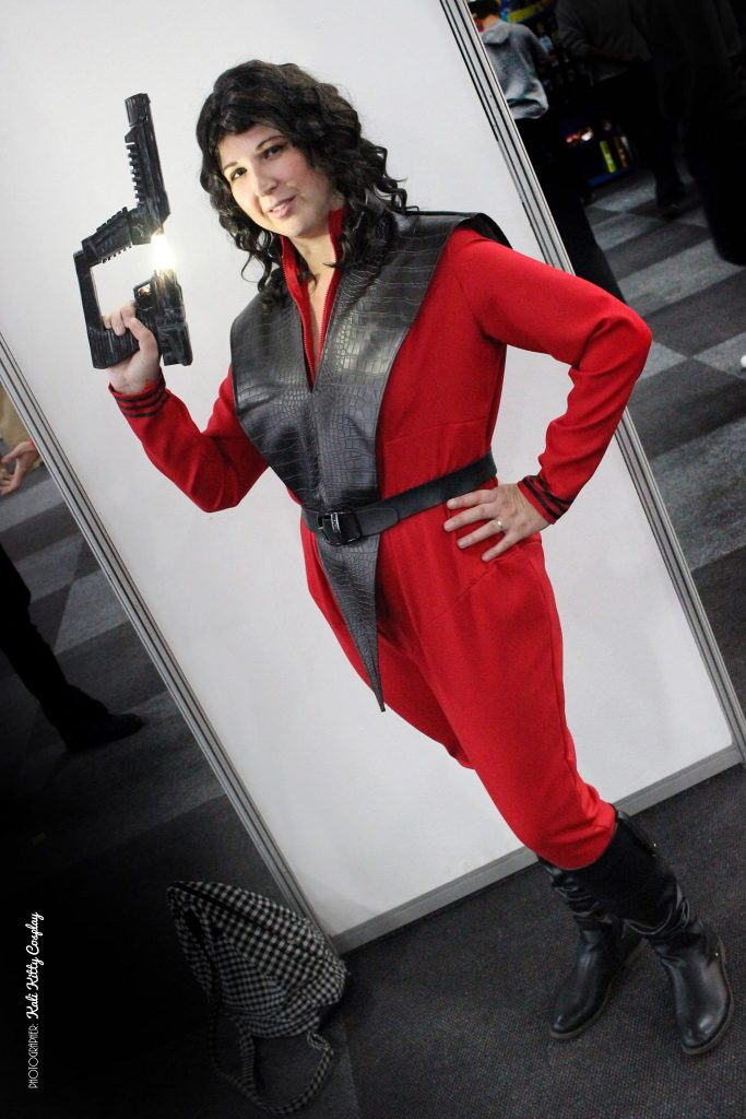 full body photograph of Diana Cosplay holding Laser gun