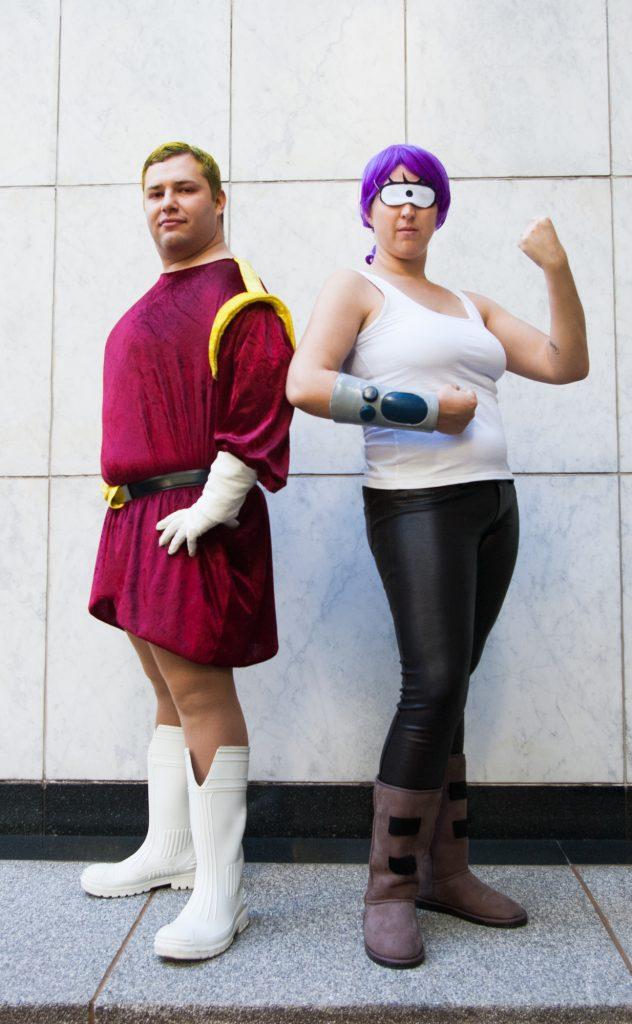 Zapp Brannigan Cosplay and Leela Cosplay standing posing back to back